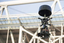 A Television Camera Hangs On C...