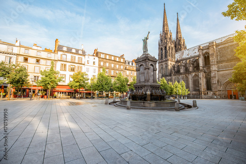 Morning view on the Victory square with monument and cathedral in Clermont-Ferrand city in France