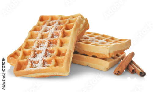 Fotografía  Tasty homemade waffles with sugar powder and cinnamon sticks on white background