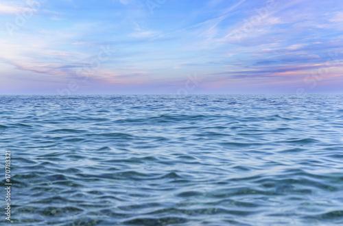 Blue sky with clouds over the sea. © Denis Rozhnovsky