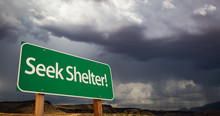 Seek Shelter Green Road Sign And Stormy Clouds
