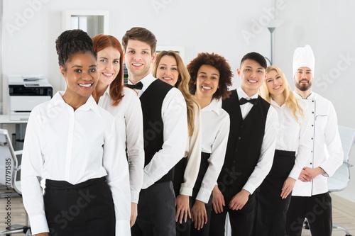 Photo  Confident Restaurant Staff Standing In Row