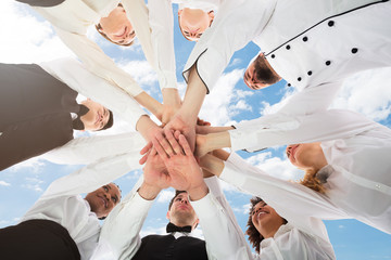 Multiracial Restaurant Staff Stacking Hands