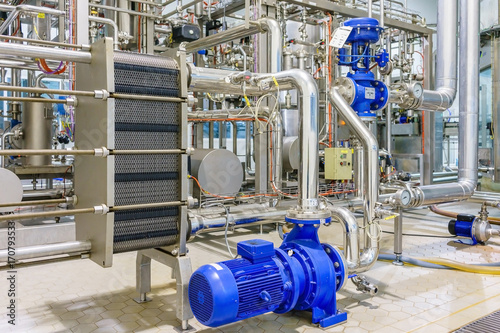 Fotografie, Obraz  metalic plate in heat exchange machine and pump in the food industrial plant