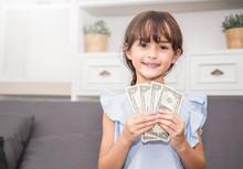 Cute Little Girl Holding Money...
