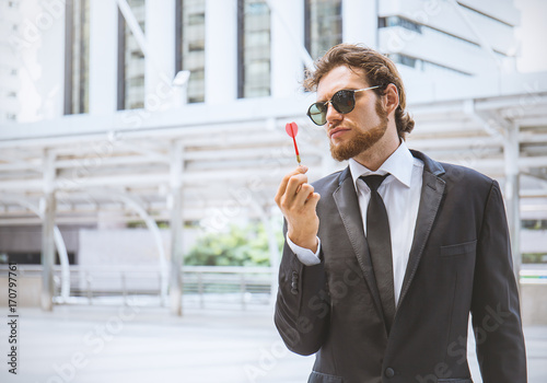 A Mid Thirties Business Man Throwing A Dart The Man Is Wearing A Suit And Tie Buy This Stock Photo And Explore Similar Images At Adobe Stock Adobe Stock