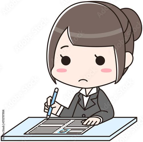 Photo 履歴書を書く女性 無表情