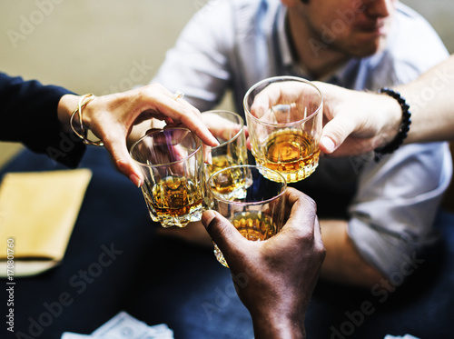 Foto auf Leinwand Alkohol Hands clinging alcohol drink glasses