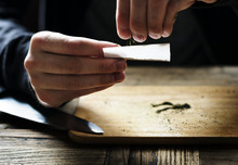 Hands Holding A Paper Making A Cigarette