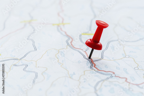 Photo  Closeup of pushpin showing the location on the map