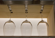 Crystal Wine Glasses In A Row Hanging