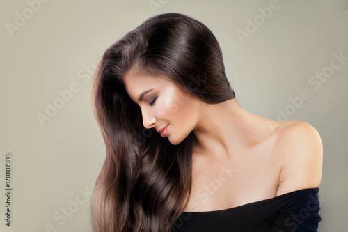Fotobehang Kapsalon Cute Model Woman with Shiny Hairstyle and Makeup, Beauty Salon or Barber Shop Background. Pretty Fashion Girl with Long Healthy Hair