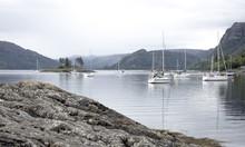 The Bay At Plockton, Scotland With Sailboats And Islands