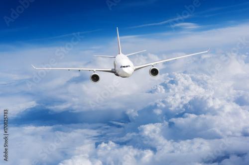 Türaufkleber Flugzeug aeroplane flying above clouds. Passenger Airliner flying