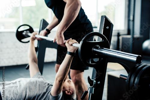 Fotografering sportsman training with trainer