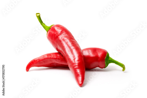 Poster Hot chili peppers Red hot chili pepper isolated on white background. Spice for a delicious meal.