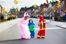 Kids On Halloween Trick Or Treat.