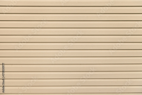Vászonkép Light brown (beige) vinyl wooden siding panel background with imitation wood texture