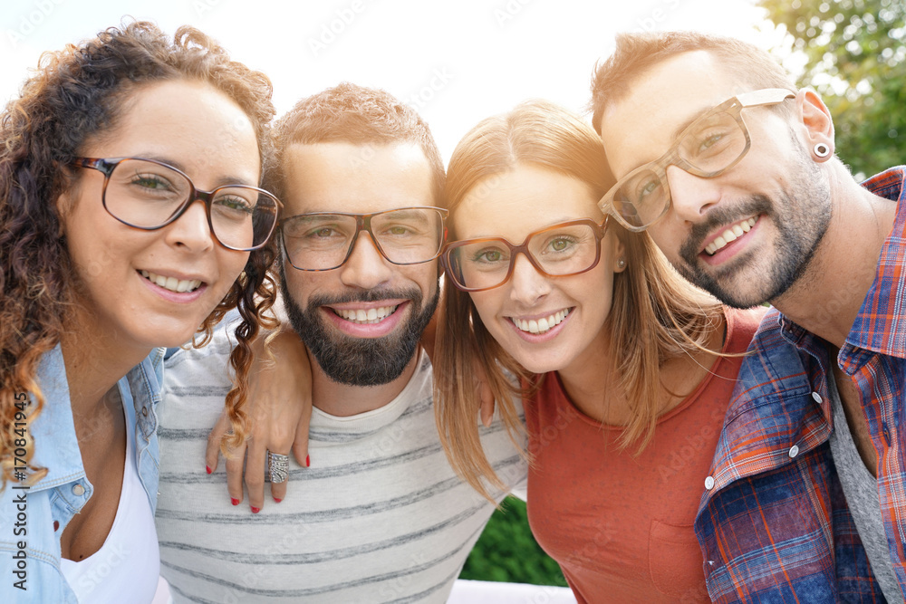 Fototapeta Portrait of young adults with eyeglasses