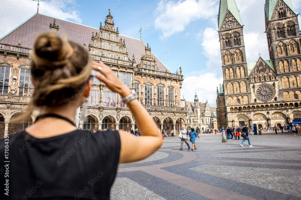 Fototapety, obrazy: Young woman tourist enjoying great view on the city hall building and church in the centre of Bremen, Hamburg