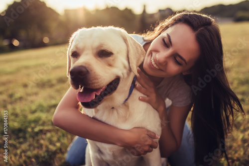 Young woman with dog Canvas Print