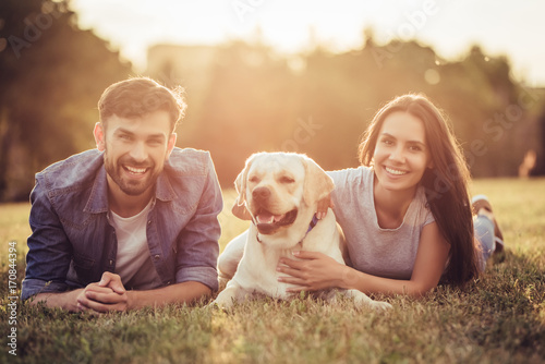 Photo  Couple with dog