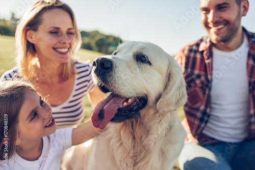 Happy family with dog Wallpaper Mural