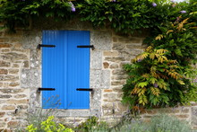 Closed Blue Shutters In An Ancient Building In France
