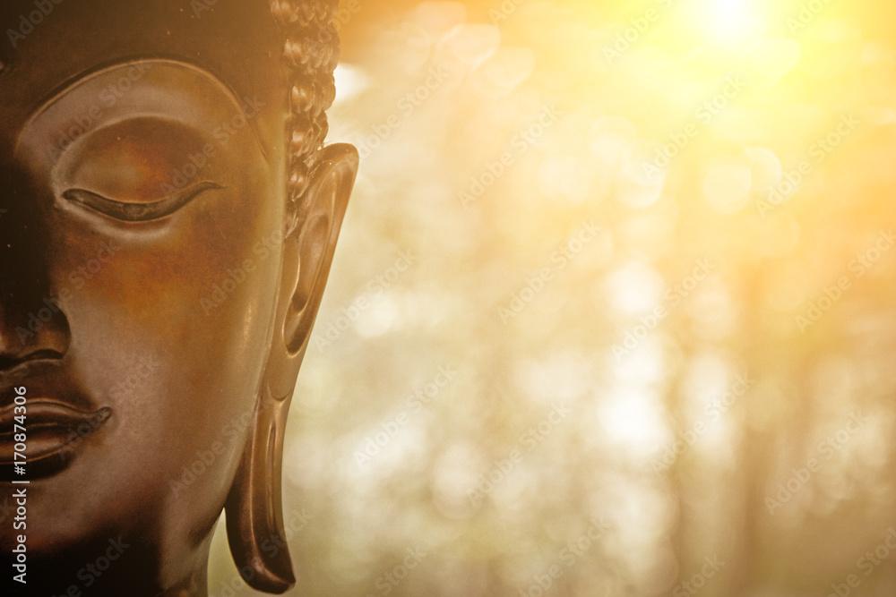 Fototapeta the Head of Buddha Statue.