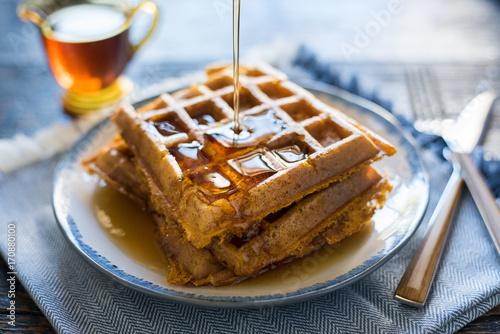 Fotografía Pouring Syrup on Pumpkin Waffles