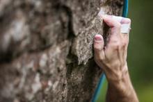 Rock Climber's Hand Gripping H...