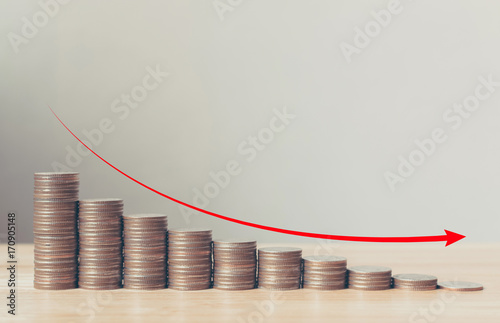 Fototapeta Coin stack step down graph with red arrow, Risk management business financial and investment, Copy space obraz