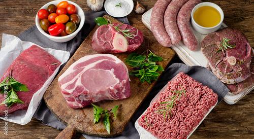 Door stickers Meat Fresh raw meat on dark wooden background.