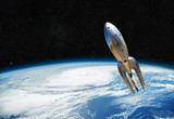 Fototapeta Space - vintage metal spaceship is flying near the earth. Beginning of the space way