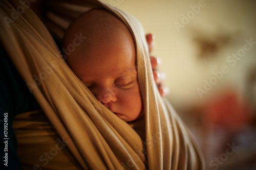 Photo  Infant sleeping in a sling