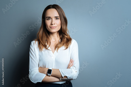 Confident beautiful businesswoman being ready to work