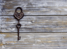 Heart And Key On Wooden Background