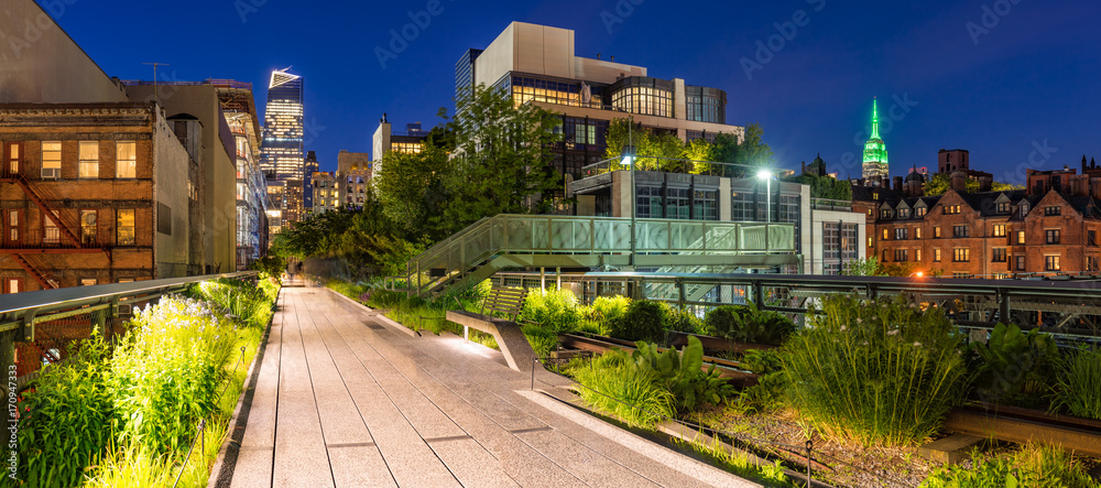 Fototapety, obrazy: Panoramic view of the High Line promenade at twilight with city lights and illuminated skyscrapers. Chelsea, Manhattan, New York City