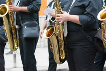 Sax Musician Walking In The Street