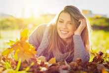 Beautiful Young Woman Smiling In Autumn In Park
