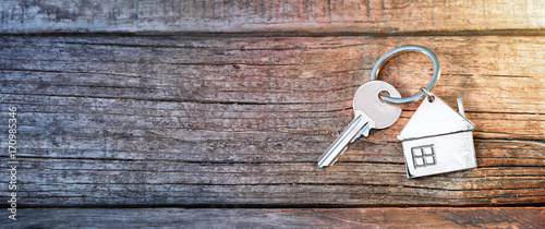 House Key And Keychain On Wooden Table Canvas Print