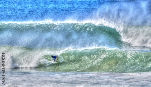Wall Murals Ocean surfers paradise beach , Queensland. surfer riding waves.