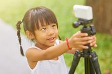 Little Thai Girl Holding Photo...