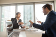 Two company leaders intensely discussing or arguing because of contract terms, can not come to agreement during negotiation, disagree with colleague opinion about business results. Dissatisfied client