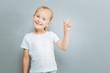 Delighted little child raising her forefinger