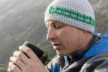 Young Hiker Drinks A Hot Tea D...