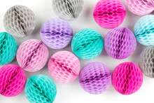 Honeycomb Balls Decorations Background. Pink, Lilac And Turquoise  Paper Pom Pom. Flat Lay. Holiday Concept