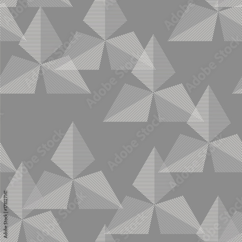 geometryczny-wzor-z-kropek-na-szarym-tle