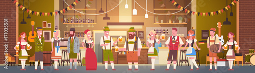 Tableau sur Toile Group Of People Drink Beer In Bar Oktoberfest Party Celebration Man And Woman We