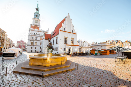 View on the Market square with Mars fountain and city hall during the morning light in Poznan in Poland